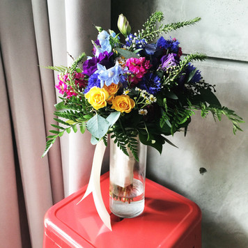 garden style bouquet in hot pink, blue, purple and yellow