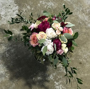 large bohemian style bouquet of peonies and garden roses