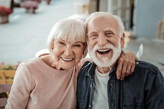 Elderly couple. Joyful nice elderly couple smiling while being in a great mood.jpg