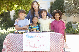 Group Of Children Holding Bake Sale With Mother.jpg