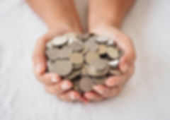 Woman hands holding coins on white backg