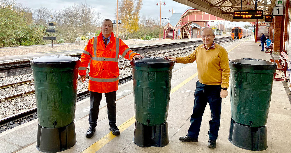 Ian Taylor, Stratford upon Avon Line Manager for West Midlands Railway and Fraser Pithie, Secretary of SLPG and who leads the Friends of the Shakespeare Line adopters group takes delivery of some of the water butts provided by Severn Trent on Tuesday 24 November 2020
