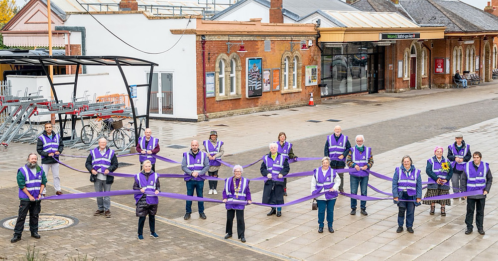 With one station adopter representing each station along the line, including Vivienne Wilkes President of Birmingham Rotary International and also station adopter at Yardley Wood, a total of 17 Shakespeare Line Station Adopters pictured at Stratford upon Avon Railway Station on World Polio Day having receiving their purple crocus corms from Rotary International which will now be planted at every station along the route between Birmingham and Stratford upon Avon.