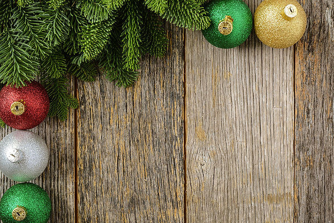 christmas-pine-needle-and-ornaments-on-a-rustic-wood-background-brandon-bourdages.jpg