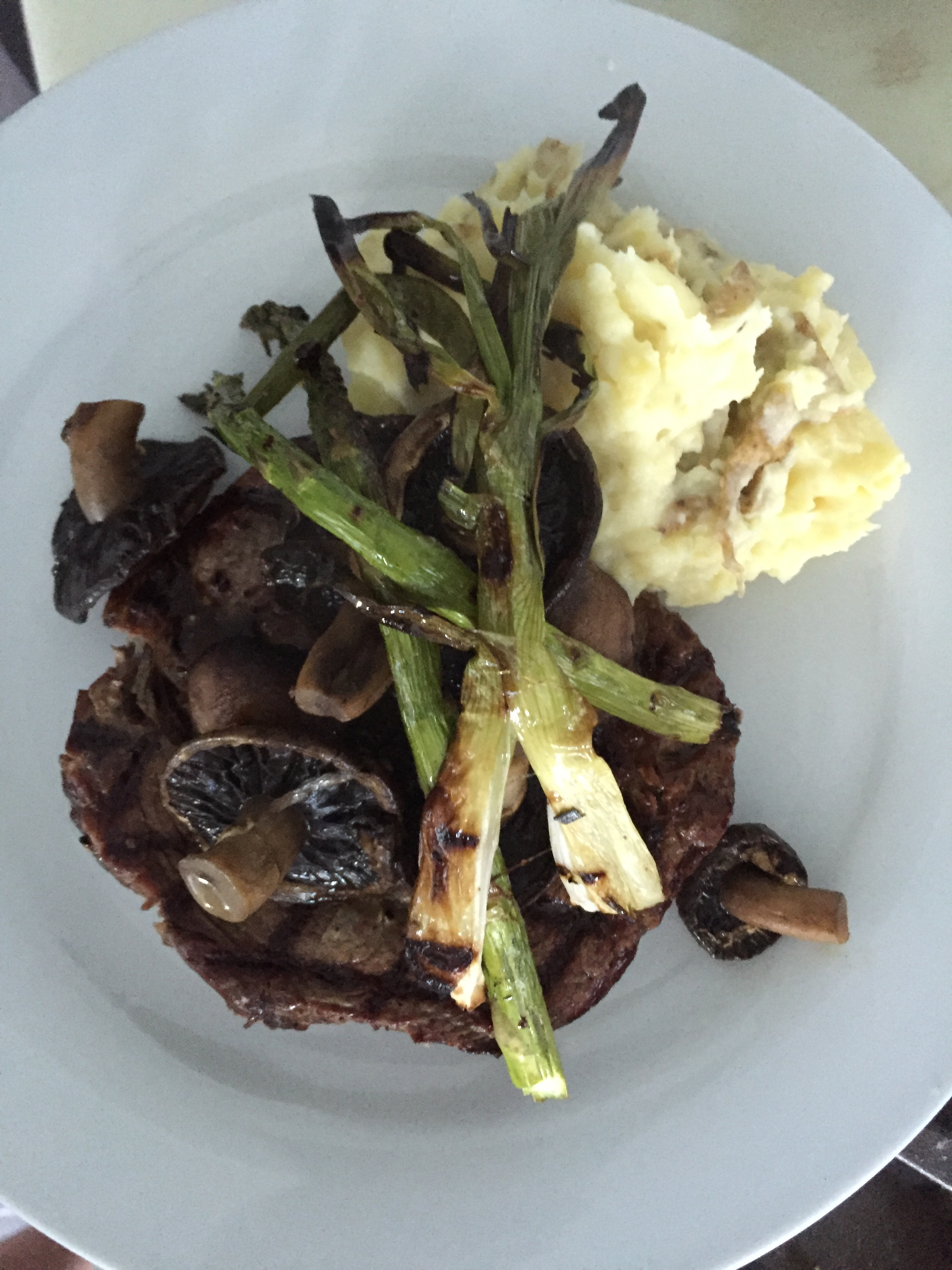 grilled steak, mushrooms and garden asparagus served with garlic mashed potatoes