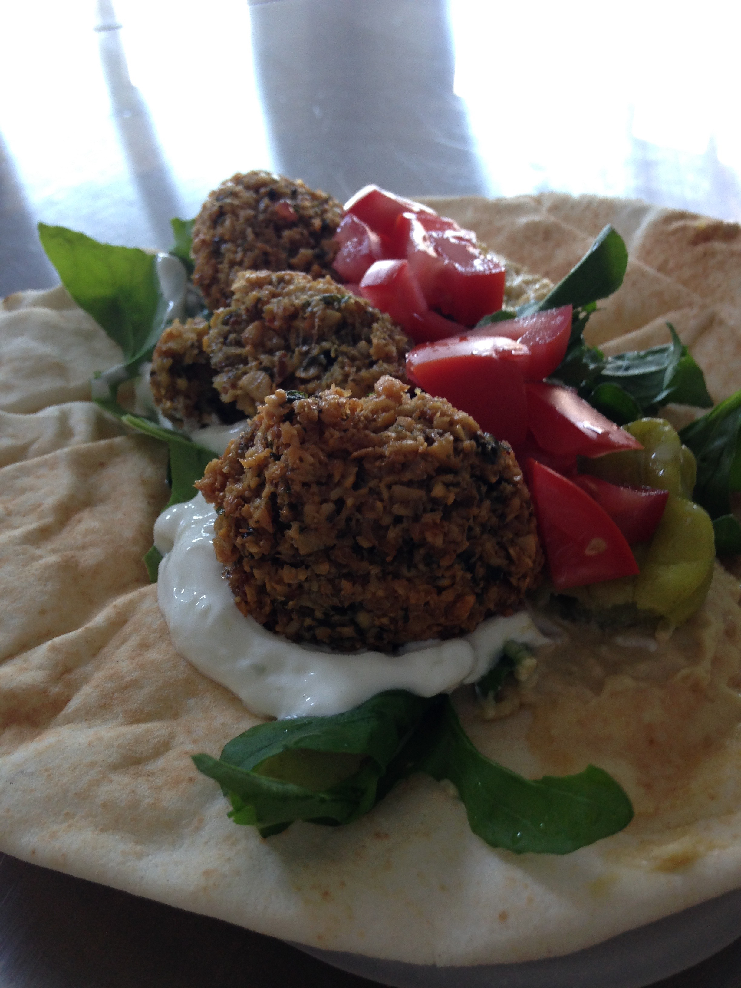 falafel with yogurt garlic dill sauce and fresh garden veg
