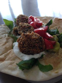 falafel with yogurt garlic dill sauce and fresh garden veg