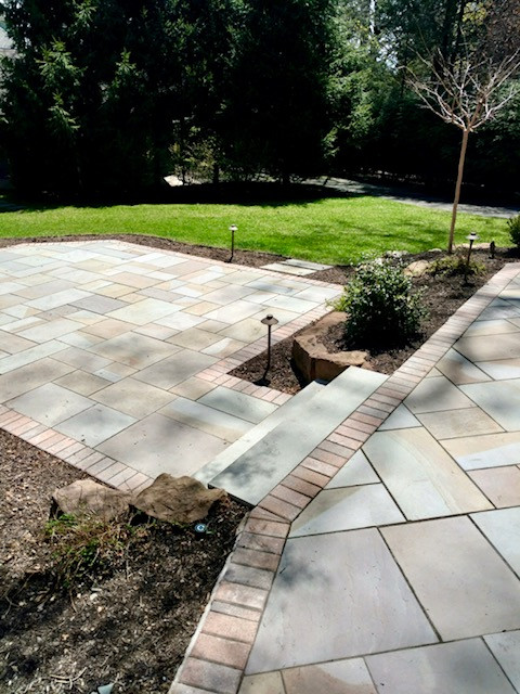 Two-Tiered Bluestone Patio with Paver Border