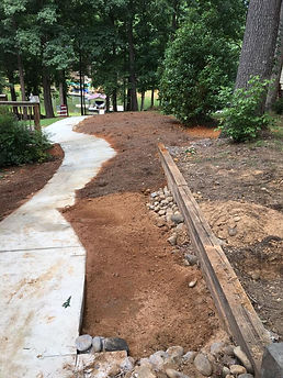 A yard with dirt covering a septic tank installation in Atlanta, GA