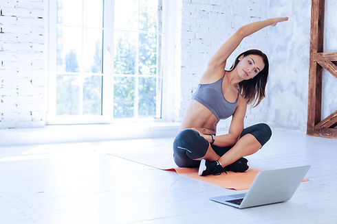 Online training. Delighted sportswoman c