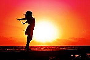 beach-woman-sunrise-silhouette-40192.jpg