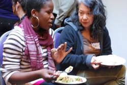 2 guests talking in sangha