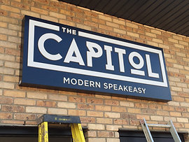 The Capitol Lit Up Sign