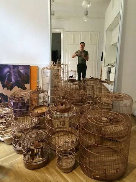 Anh Tuan shooting his collection of wooden Vietnamese bird cages in his showroom
