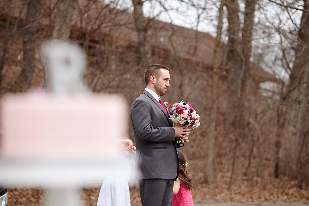 The groom, patiently waiting his turn at photos. Floral by LeJardin of Rochester