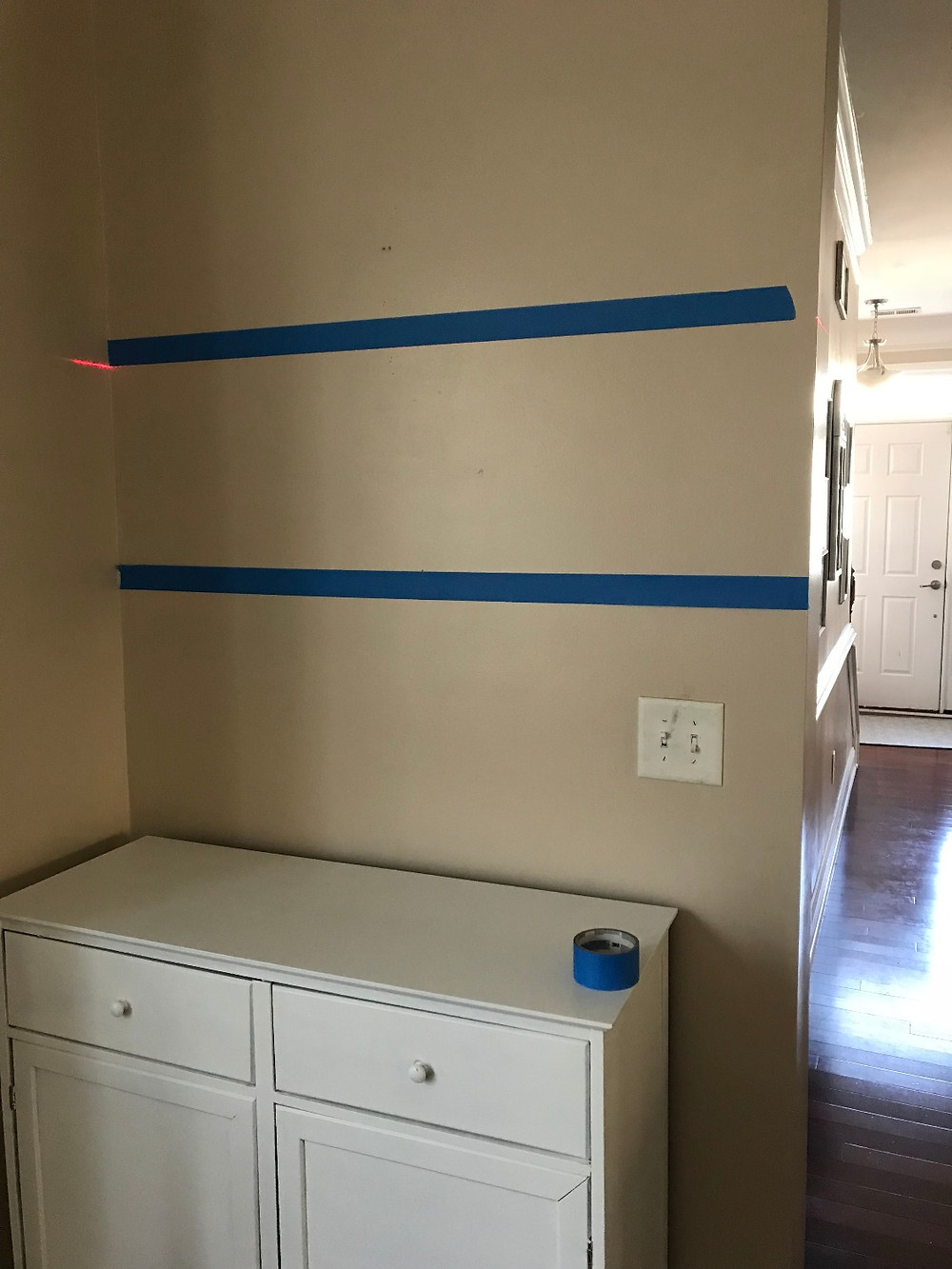 laser level with painter's tape