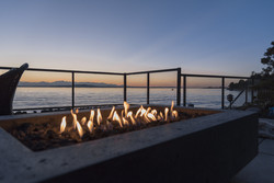 Gas lit fireplace by the sea at sunset