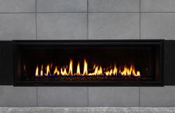 Sleek modern gas fireplace with gray til