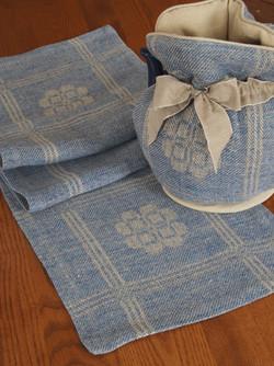 heather blue linen runner and tea cozy