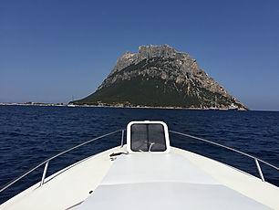 A boat traveling toTavolara Island in Sardinia Italy