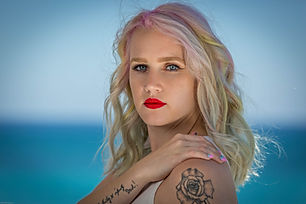 Color portrait of female model with tattoos