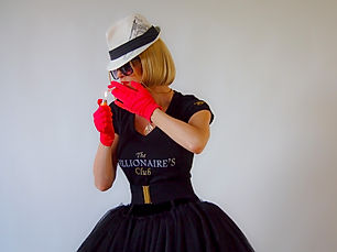 A model dressed up lighting a cigarette wearing  red gloves