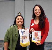 Jennifer Chun exchanges banners with Tara Strickland visting Skalleauge from Melbourne
