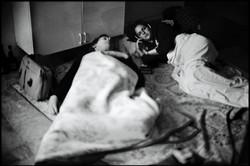 Two CNN camerawomen sleep on the flo
