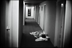 Hotel guests sleep in the hallway of