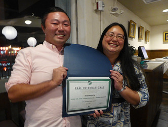 Ryan Nagata recieves his Young Skal Professional certificate from President Jennifer Chun