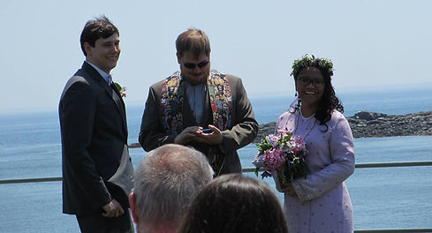 Happy Couple with Reverend Carleton on the coast of Maine
