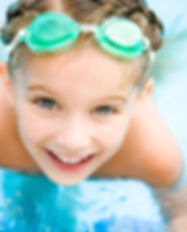 Pretty little girl in swimming pool.jpg