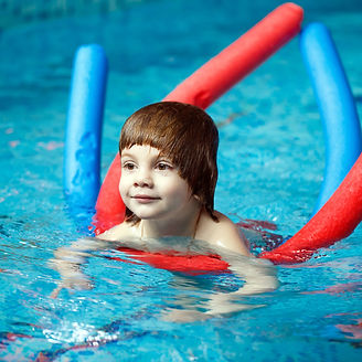 Child swims in the pool..jpg