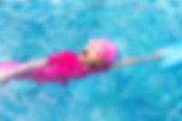 Cute little girl learning to swim.jpg