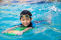 boy learn to swim in the swimming pool.j