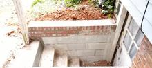 Rebuilt retainer wall