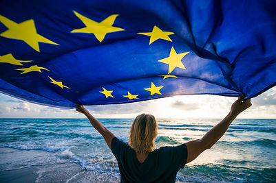 Man holding EU European Union flag wavin