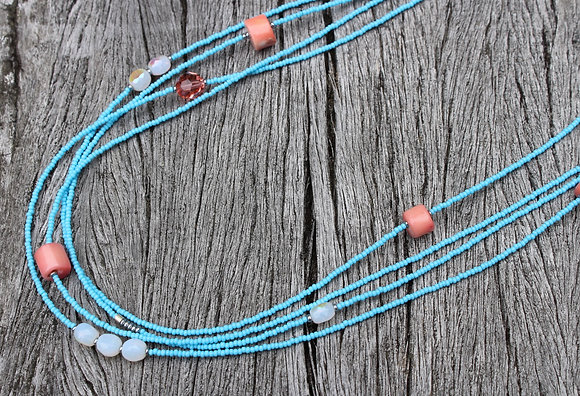 Coral and Swarovski Crystals and Moonstone Glass