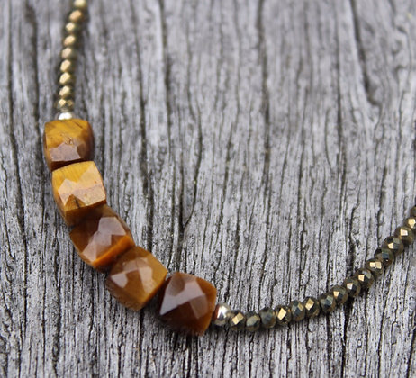 Golden Tiger Eye on Gold Spinel