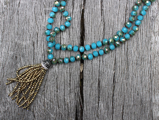 Hand Knotted Blue Czech Glass with Gold Tassel
