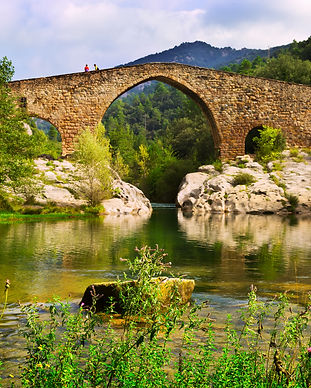 mountain-river-with-medieval-bridge-pyre