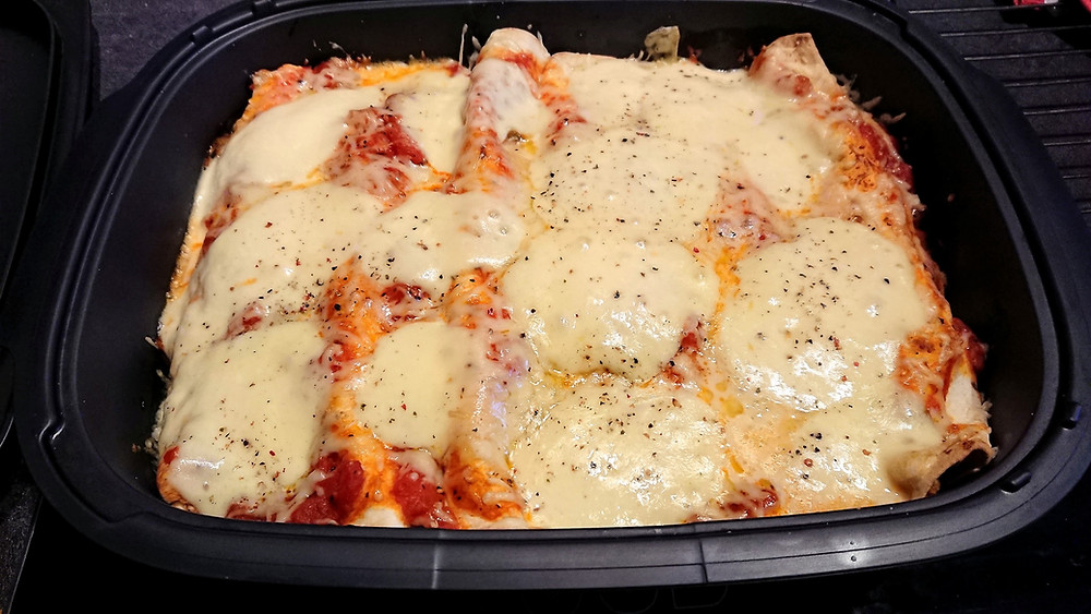 Enchiladas poulet et mozzarella dans l'ultra pro Tupperware