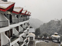 Hotel with Snow falling over