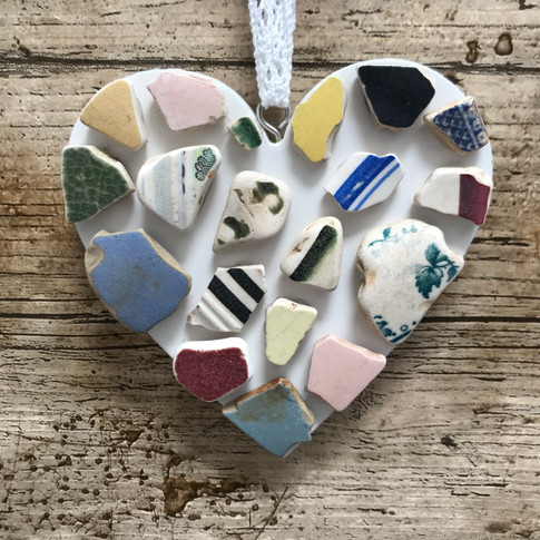 wooden heart with sea pottery