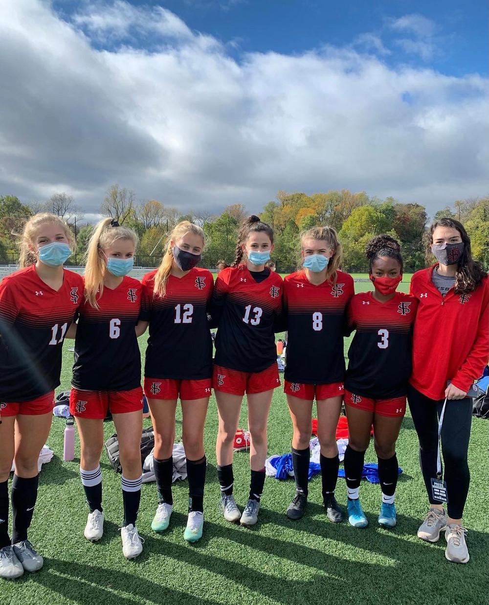 Senior Girls' Varsity Soccer players post-win in October 2020