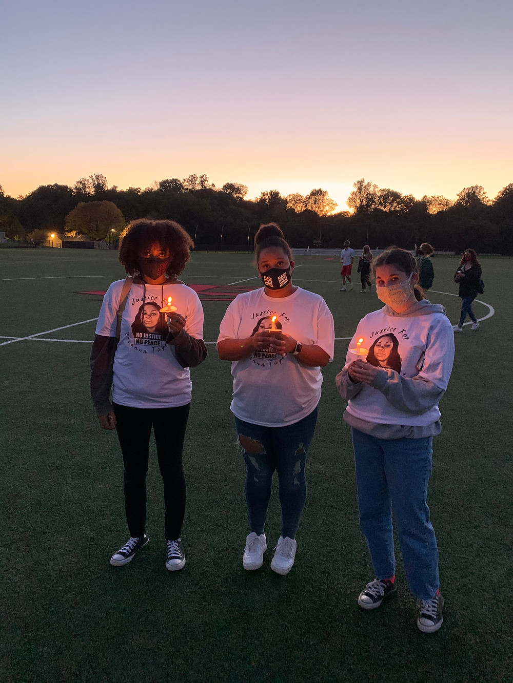 Students Amina West, Kayla Kurtz, and Bryce Carlin attend a vigil on the Friends campus for police shooting victim Breonna Taylor: a peaceful commemoration in a summer when many protests were met with violence.
