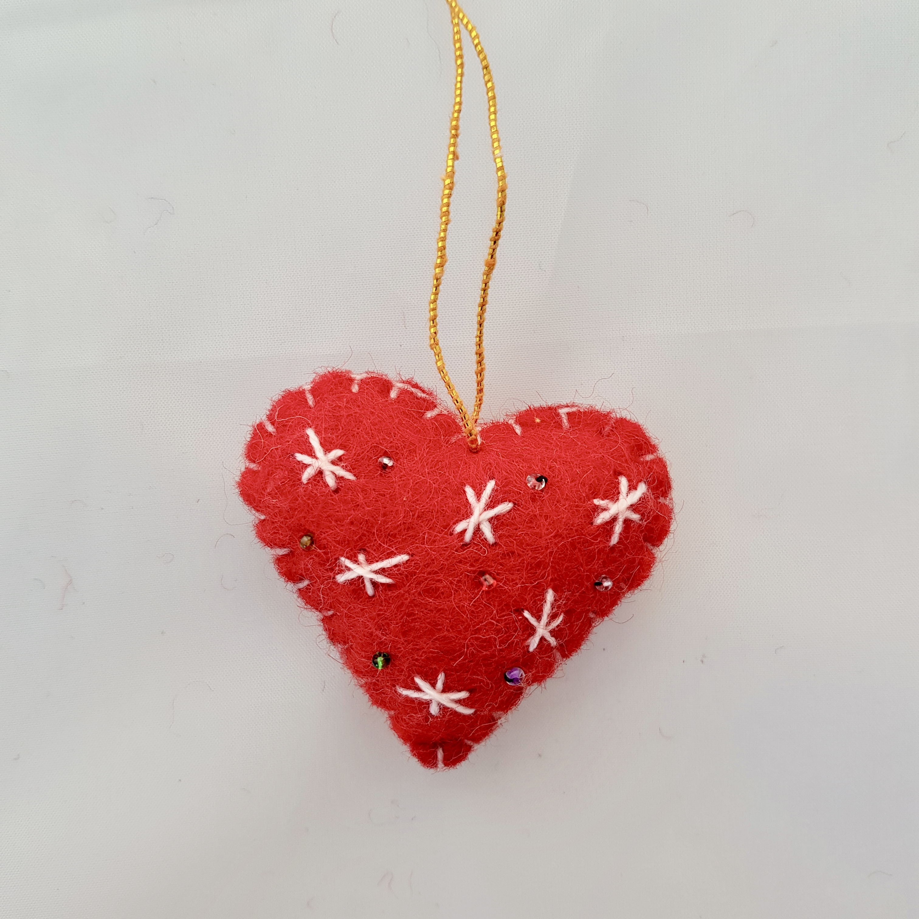 Red and white heart tree hanging.