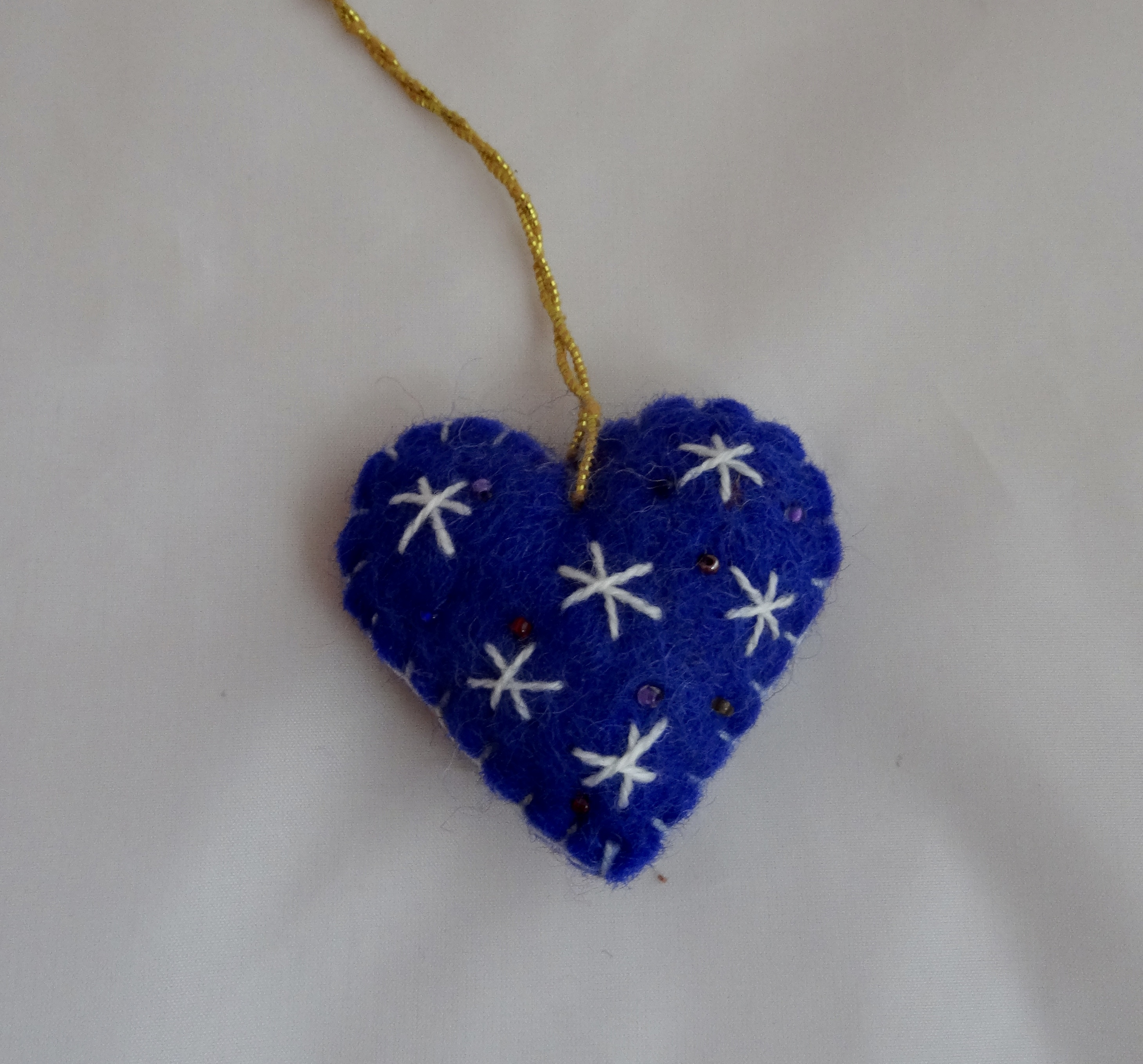 Blue and white heart tree hanging.