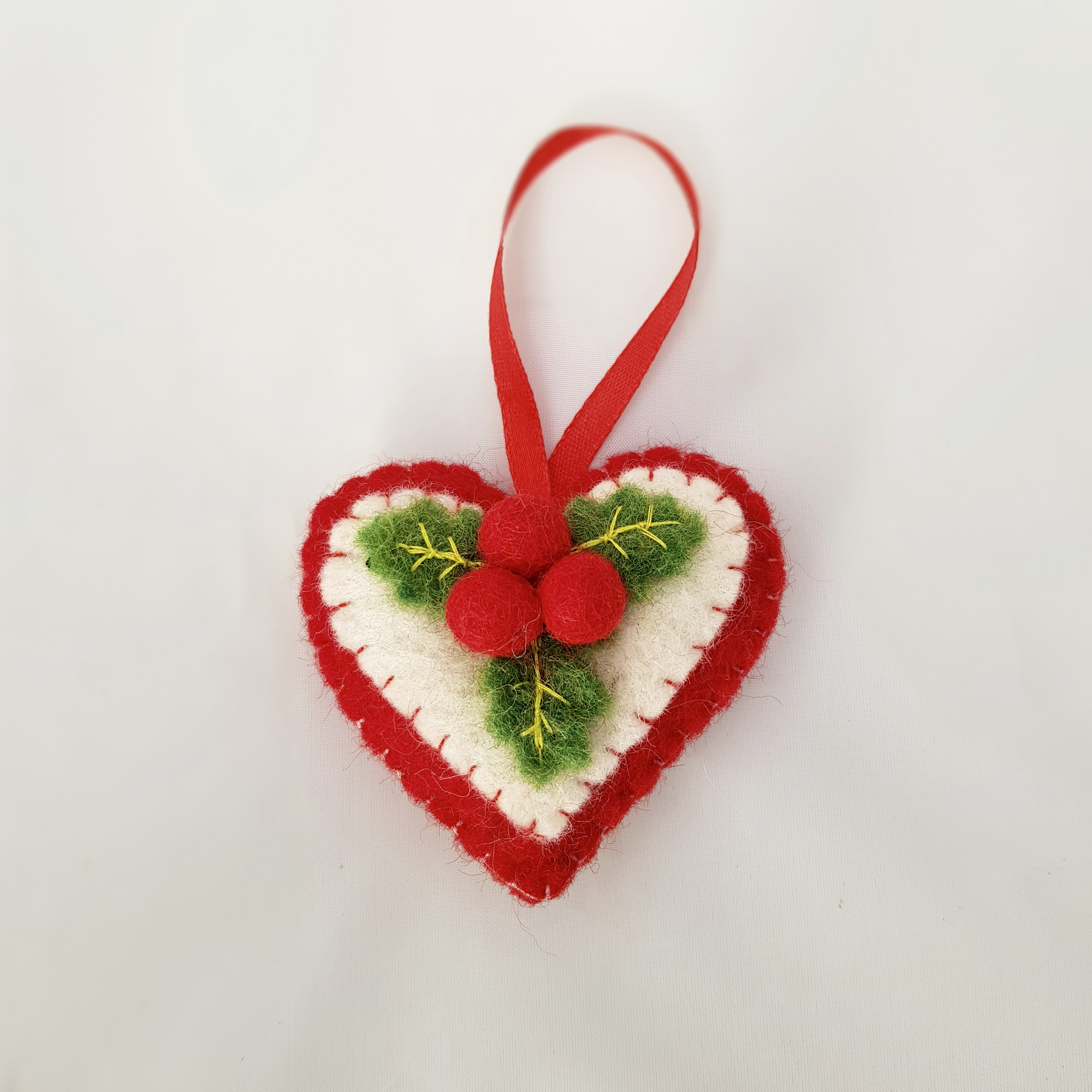 Heart with holly tree hanging.