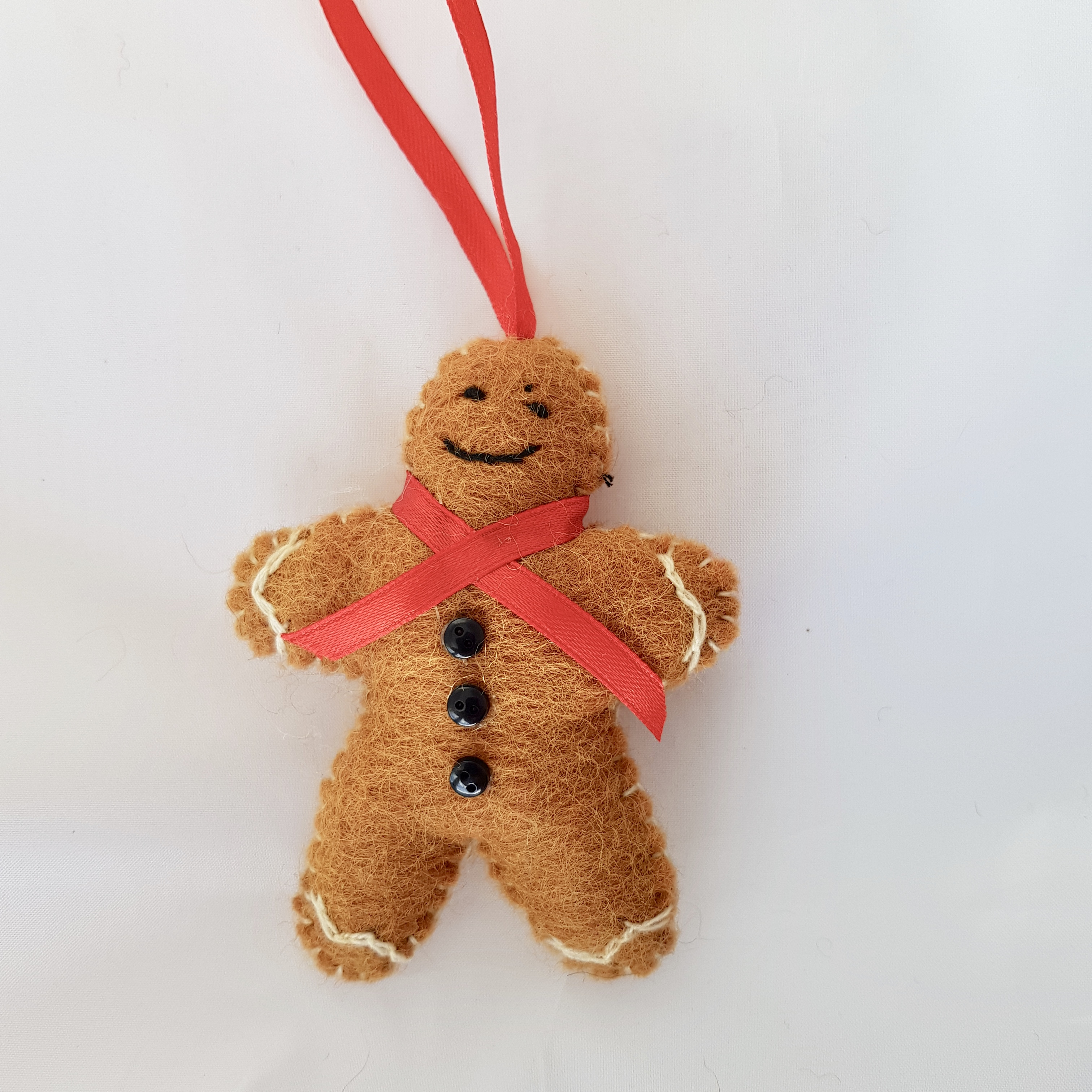 Gingerbread person tree hanging.